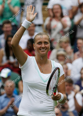 Petra Kvitova of the Czech Republic reacts after defeating Akgul Amanmuradova of Uzbekistan in a first round women's singles match at the All England Lawn Tennis Championships at Wimbledon, England