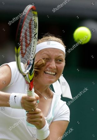 Petra Kvitova of the Czech Republic returns a shot to Akgul Amanmuradova of Uzbekistan during a first round women's singles match at the All England Lawn Tennis Championships at Wimbledon, England
