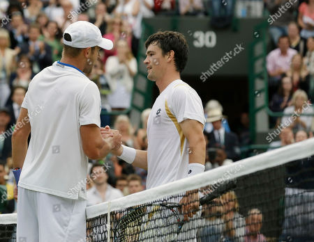 Andy Roddick of the United States, left, is congratulated by Jamie Baker of Britain after defeating him in a first round men's singles match at the All England Lawn Tennis Championships at Wimbledon, England