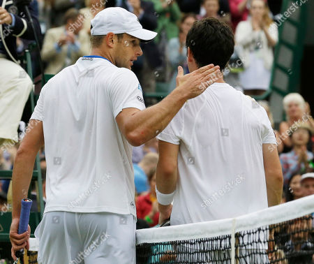 Andy Roddick of the United States, left, and Jamie Baker of Britain walk off the court after Roddick won their first round men's singles match at the All England Lawn Tennis Championships at Wimbledon, England