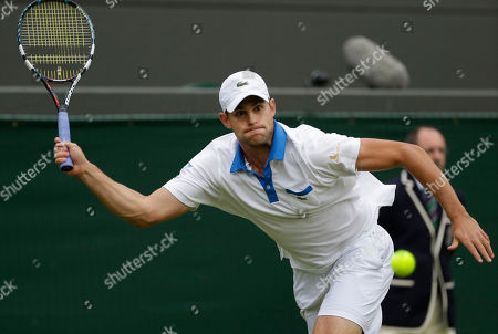 Andy Roddick of the United States returns a shot to Jamie Baker of Britain during a first round men's singles match at the All England Lawn Tennis Championships at Wimbledon, England