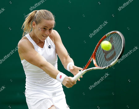 Anastasiya Yakimova of Belarus returns a shot against Julia Goerges of Germany during a second round women's singles match at the All England Lawn Tennis Championships at Wimbledon, England