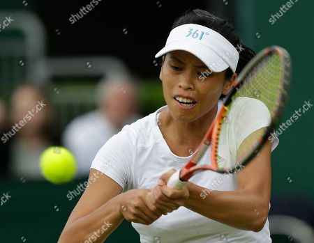Su-Wei Hsieh of Taiwan returns a shot to Stephanie Foretz Gacon of France during a second round women's singles match at the All England Lawn Tennis Championships at Wimbledon, England