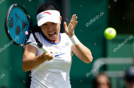 Zheng Jie of China returns a shot to Stephanie Dubois of Canada during a first round women's singles match at the All England Lawn Tennis Championships at Wimbledon, England