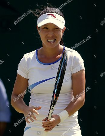 Zheng Jie of China reacts during a first round women's singles match against Stephanie Dubois of Canada at the All England Lawn Tennis Championships at Wimbledon, England
