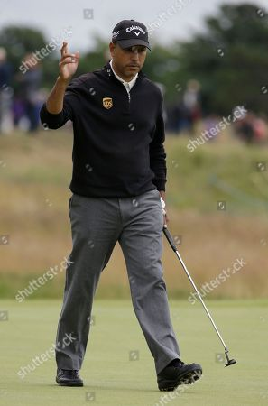 Jeev Milkha Singh of India reacts after playing a birdie on the fourth hole at Royal Lytham & St Annes golf club during the second round of the British Open Golf Championship, Lytham St Annes, England
