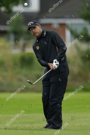 Jeev Milkha Singh of India chips onto the second green at Royal Lytham & St Annes golf club during the first round of the British Open Golf Championship, Lytham St Annes, England