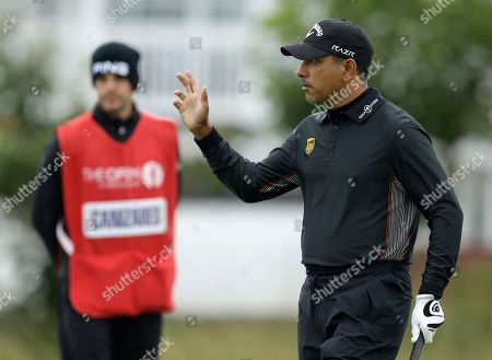 Jeev Milkha Singh Jeev Milkha Singh of India reacts to the crowd after his putt on the 2nd green at Royal Lytham & St. Annes golf club during the first round of the British Open Golf Championship, in Lytham St. Annes, England