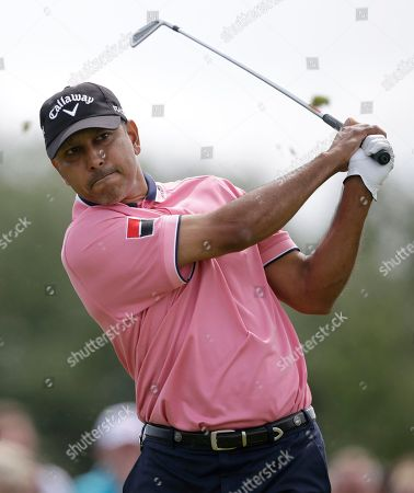 Jeev Milkha Singh of India plays a shot off the third tee at Royal Lytham & St Annes golf club during the third round of the British Open Golf Championship, Lytham St Annes, England