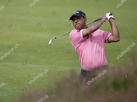 Jeev Milkha Singh of India plays a shot on the second hole at Royal Lytham & St Annes golf club during the third round of the British Open Golf Championship, Lytham St Annes, England