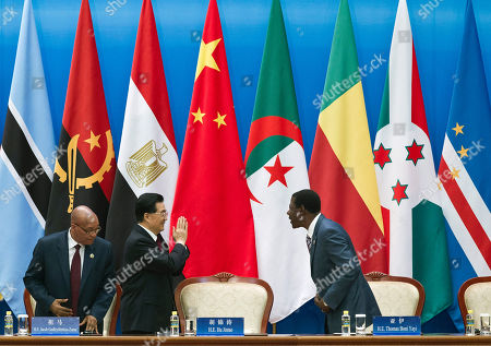 "Hu Jintao, Thomas Yayi Boni, Jacob Zuma Chinese President Hu Jintao, center, gestures to Benin's President Thomas Yayi Boni, right, as South African President Jacob Zuma, left, looks on after Hu delivered an opening speech for the 5th Ministerial Conference of the Forum on China-Africa Cooperation held at the Great Hall of the People in Beijing, China . Hu on Thursday pledged African governments $20 billion in credit over the next three years and called for more China-Africa coordination in international affairs to defend against the ""bullying"" of richer powers"