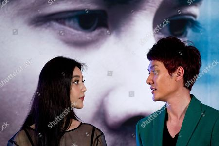 """Fan Bingbing, Feng Shaofeng Chinese actress Fan Bingbing, left, and actor Feng Shaofeng, right, attend a press conference to promote their new movie """"Double Exposure"""" in Beijing"""