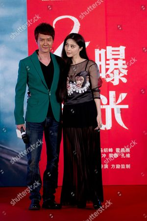 """Fan Bingbing, Feng Shaofeng Chinese actress Fan Bingbing, right, and actor Feng Shaofeng, left, pose for photos during a press conference to promote their new movie """"Double Exposure"""" in Beijing"""