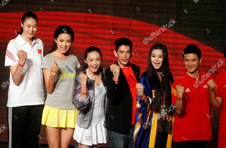 From left, former Olympic volleyball player Zhao Ruirui, former Miss World Zhang Zilin, Chinese actress Yao Chen, Adidas managing director of Greater China, Colin Currie, Chinese actress Fan Bingbing and former Olympic diver Tian Liang pose with red wrist bands to show support for Chinese athletes ahead of the London Olympic Games in Beijing