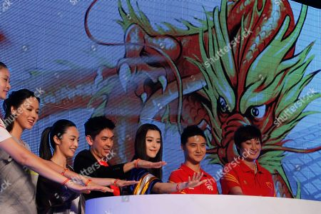 From left former Olympic volleyball athlete Zhao Ruirui, former Miss World Zhang Zilin, Chinese actress Yao Chen, Adidas managing director of Greater China, Colin Currie, Chinese actress Fan Bingbing, former Olympic diver Tian Liang and former Olympic volleyball plaer Yang Hao prepare to mark the launch of red wrist bands used to show support for Chinese athletes ahead of the London Olympic Games in Beijing, China