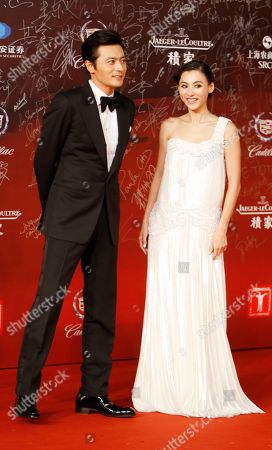 Jang Dong-Gu, Cecilia Cheung South Korean actor Jang Dong-Gu, left, and Hong Kong actress Cecilia Cheung, pose on the red carpet prior to the opening ceremony of the Shanghai International Film Festival at Shanghai Grand Theater in Shanghai, China