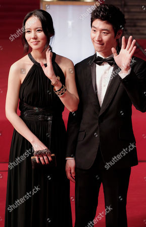 Han Ga-in, Lee Je-hoon South Korean actors Han Ga-in, left, and Lee Je-hoon wave to fans on the red carpet prior to the closing ceremony of the Shanghai International Film Festival at Shanghai Grand Theater in Shanghai, China