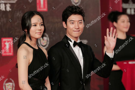 Han Ga-in, Lee Je-hoon South Korean actors Han Ga-in, left, and Lee Je-hoon pose on the red carpet prior to the closing ceremony of the Shanghai International Film Festival at Shanghai Grand Theater in Shanghai, China
