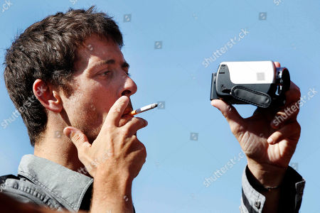 French Journalist Romeo Langlois smokes as he films after being released in San Isidro, southern Colombia, . French journalist Romeo Langlois, who was taken by rebels on April 28 when they attacked troops he was accompanying on a cocaine-lab eradication mission, was handed over by the rebels to a delegation that included a French diplomat in San Isidro