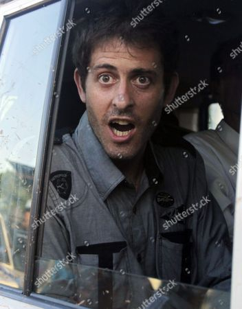 French journalist Romeo Langlois looks out a Red Cross car window in San Isidro in southern Colombia, . Langlois, who was taken by rebels of the Revolutionary Armed Forces of Colombia (FARC) on April 28 when they attacked troops he was accompanying on a cocaine-lab eradication mission, was handed over by the rebels to a delegation in San Isidro on Wednesday