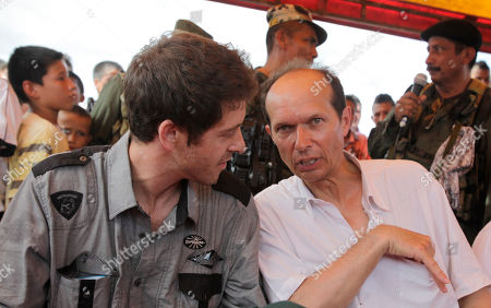 French diplomat Jean-Baptiste Chauvin, right, talks to released French journalist Romeo Langlois in San Isidro in southern Colombia, . French journalist Romeo Langlois, who was taken by rebels on April 28 when they attacked troops he was accompanying on a cocaine-lab eradication mission, was handed over by the rebels to a delegation that included Jean-Baptiste Chauvin in San Isidro