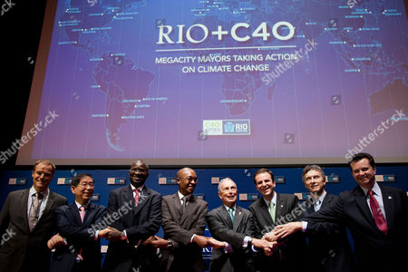 Mayors from left to right, Ecktar Wuerzner of Heidelberg, Won Soon Park of Seoul, Babatunde Fashola of Lagos, Franklyn Tau of Johannesburg, Michael Bloomberg of New York, Eduardo Paes of Rio de Janeiro, Eduardo Macri of Buenos Aires and Gilberto Kassab of Sao Paulo, pose for a photo during the Rio+C40 meeting, a parallel event to the UN Conference on Sustainable Development, or Rio+20, in Rio de Janeiro, Brazil, . While squabbling between rich and poor countries threatens to derail the Earth summit, the world's mayors say they can't afford the luxury of endless, fruitless negotiations and are already taking real action to stave off environmental disaster and preserve natural resources for future generations