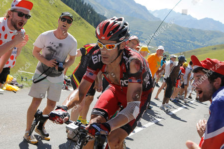 George Hincapie of The US, his shirt torn after a crash, climbs Peyresourde pass during the 16th stage of the Tour de France cycling race over 197 kilometers (122.4 miles) with start in Pau and finish in Bagneres-de-Luchon, France