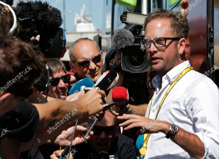 "Jonathan Vaughters, a director of Garmin-Sharp, right, denied that any of the cycling team's riders have been banned for six months by the U.S. Anti-Doping Agency as part of its doping probe into seven-time Tour de France winner Lance Armstrong during an improvised press conference outside the team bus prior to the start of the fifth stage of the Tour de France cycling race over 196.5 kilometers (122 miles) with start in Rouen and finish in Saint-Quentin, France, . Vaughters said Thursday that a Dutch media report about six-month bans is ""completely untrue."" Dutch newspaper De Telegraaf reported Wednesday that Vaughters and four other former Armstrong teammates have been given six-month bans to begin in late September. De Telegraaf cites unnamed ""well-informed sources"" in its report that Vaughters, George Hincapie, Levi Leipheimer, David Zabriskie and Christian Vande Velde received the bans after admitting to doping and agreeing to give evidence against Armstrong"