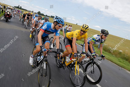 David Zabriskie of the US, Fabian Cancellara of Switzerland, wearing the overall leader's yellow jersey, and Stuart O'Grady of Australia, from left to right, ride in the pack during the fifth stage of the Tour de France cycling race over 196.5 kilometers (122 miles) with start in Rouen and finish in Saint-Quentin, France, . Zabriskie is one of five former teammates of seven-time Tour de France winner Lance Armstrong who, according to Dutch newspaper De Telegraaf, have struck a deal with the US anti doping agency USADA to admit to using doping and to give evidence against Armstrong in exchange for what is considered a light punishment, a 6-month ban on professional cycling