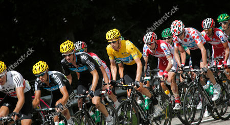 Edvald Boasson Hagen of Norway, left, Bradley Wiggins of Britain, wearing the overall leader's yellow jersey, center, Denis Menchov of ~Russia, fifth from right, and Christopher Froome of Britain, wearing the best climber's dotted jersey, ride during the 8th stage of the Tour de France cycling race over 157.5 kilometers (98.5 miles) with start in Belfort, France, and finish in Porrentruy, Switzerland