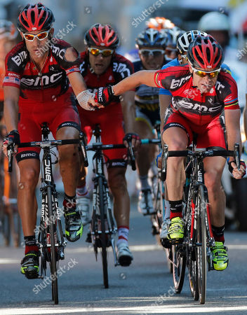 Cadel Evans of Australia, left, thanks teammate George Hincapie of The US, left, when crossing the finish line of the 16th stage of the Tour de France cycling race over 197 kilometers (122.4 miles) with start in Pau and finish in Bagneres-de-Luchon, France