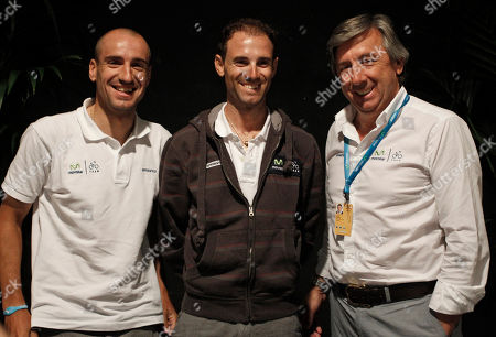 Stock Photo of Alejandro Valverde of Spain, center, teammate Juan Jose Cobo Acebo, left, and team director Jose Luis Arrieta, right, pose for photographers after a press conference in Liege, Belgium, . The Tour de France cycling race starts on Saturday June 30 with the prologue, an individual time trial over 6,4 kilometers (4 miles) with start and finish in Liege, Belgium