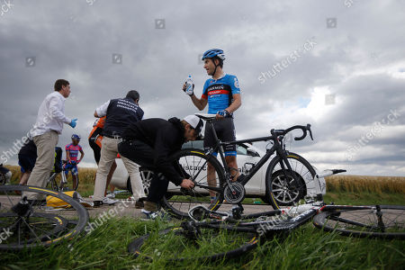 Christian Vandevelde of the US waits for a mechanic to fix his bicycle after a crash in the pack at some 25 kilometers from the finish line during the sixth stage of the Tour de France cycling race over 207.5 kilometers (129 miles) with start in Epernay and finish in Metz, France