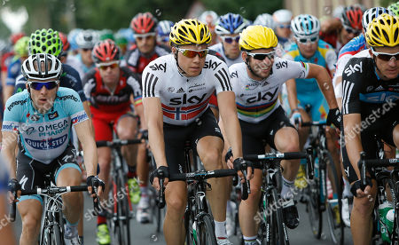 Levi Leipheimer of the US, left, Cadel Evans of Australia, second left rear, Edvald Boasson Hagen of Norway, center, and Mark Cavendish of Britain, second right, ride in the pack during the third stage of the Tour de France cycling race over 197 kilometers (122.4 miles) with start in Orchies and finish in Boulogne-sur-Mer, northern France
