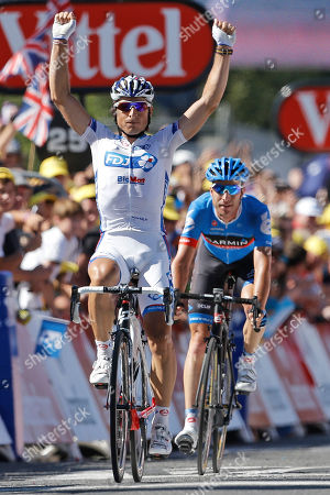 Pierrick Fedrigo of France crosses the finish line ahead of Christian Vandevelde of the US, right, to win the 15th stage of the Tour de France cycling race over 158.5 kilometers (98.5 miles) with start in Samatan and finish in Pau, France