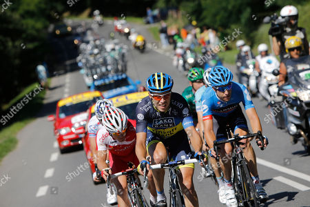 From left, Samuel Dumoulin of France, Nicki Sorensen of Denmark, and Christian Vandevelde of the US, ride in the breakaway group during the 15th stage of the Tour de France cycling race over 158.5 kilometers (98.5 miles) with start in Samatan and finish in Pau, France