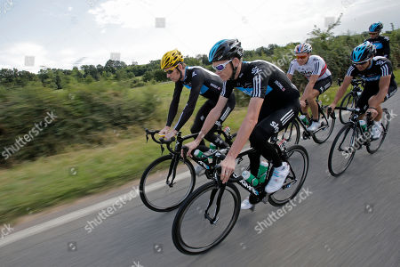 Overall leader Bradley Wiggins of Britain, rear left, Christopher Froome of Britain, center, and Edvald Boasson Hagen of Norway, third from right, ride with Sky teammates during a training on the rest day of the Tour de France cycling race in Quincie-en-Beaujolais, near Macon, France