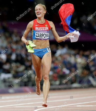 Yuliya Zaripova Russia's Yuliya Zaripova carries her national flag as she celebrates her win in the women's 3000-meters steeplechase during the athletics in the Olympic Stadium at the 2012 Summer Olympics, London. Russian athlete Yulia Zaripova faces losing her gold medal in the 3,000 steeplechase from the 2012 London Olympics after being banned for doping on Friday, Jan. 30, 2015