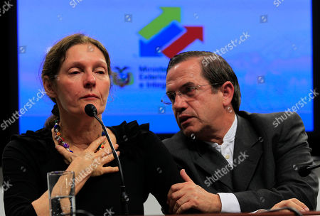 The mother of WikiLeaks founder Julian Assange, Christine Assange, is comforted by Ecuador's Foreign Minister Ricardo Patino during a press conference in Quito, Ecuador, . Christine Assange is in Ecuador to meet with officials about her son's political asylum request. Ecuadorean officials have said they will not announce a decision until after the London Olympic Games end in mid-August. The 40-year-old Australian has been holed up inside the Ecuadorian Embassy in London since applying for political asylum on June 19