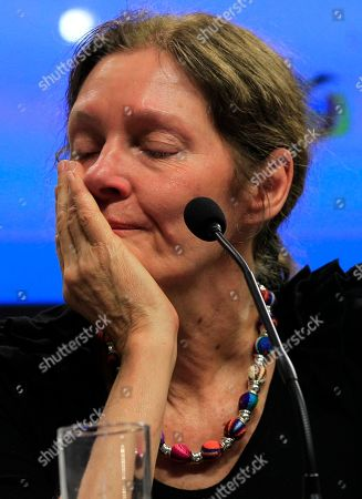 The mother of WikiLeaks founder Julian Assange, Christine Assange weeps during a press conference, after meeting with Ecuador's foreign minister, in Quito, Ecuador, . Christine Assange is in Ecuador to meet with officials about her son's political asylum request. Ecuadorean officials have said they will not announce a decision until after the London Olympic Games end in mid-August. The 40-year-old Australian has been holed up inside the Ecuadorian Embassy in London since applying for political asylum on June 19