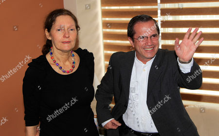 Ecuador's Foreign Minister Ricardo Patino, right, waves as he stands next to the mother of WikiLeaks founder Julian Assange, Christine Assange, during their meeting in Quito, Ecuador, . Christine Assange is in Quito to appeal to Ecuador's government to grant her son asylum. The 40-year-old Australian has been holed up inside the Ecuadorian Embassy in London since applying for political asylum on June 19