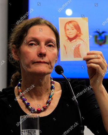 The mother of WikiLeaks founder Julian Assange, Christine Assange, holds up a picture of her son Julian when he was 4-years-old, during a press conference, after meeting with Ecuador's foreign minister in Quito, Ecuador, . Christine Assange is in Ecuador to meet with officials about her son's political asylum request. Ecuadorean officials have said they will not announce a decision until after the London Olympic Games end in mid-August. The 40-year-old Australian has been holed up inside the Ecuadorian Embassy in London since applying for political asylum on June 19