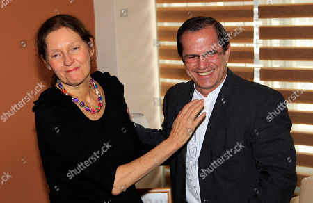Ecuador's Foreign Minister Ricardo Patino, right, talks with mother of WikiLeaks founder Julian Assange, Christine Assange, during their meeting in Quito, Ecuador, . Christine Assange is in Quito to appeal to Ecuador's government to grant her son asylum. The 40-year-old Australian has been holed up inside the Ecuadorian Embassy in London since applying for political asylum on June 19