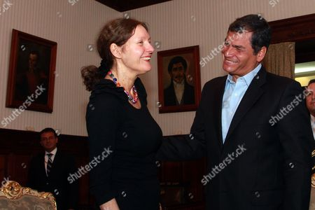 Ecuador's President Rafael Correa and the mother of WikiLeaks founder Julian Assange, Christine Assange smile during their meeting in Quito, Ecuador, . Christine Assange is in Ecuador to meet with officials about her son's political asylum request. Ecuadorean officials have said they will not announce a decision until after the London Olympic Games end in mid-August. The 40-year-old Australian has been holed up inside the Ecuadorian Embassy in London since applying for political asylum on June 19