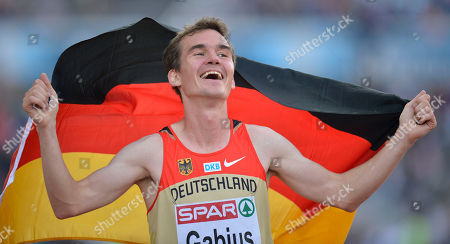 Germany's Arne Gabius reacts after winning the silver medal in the Men's 5000 meter final at the European Athletics Championships in Helsinki, Finland