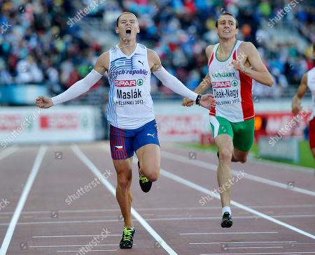 Czech Republic's Pavel Maslak, left, crosses the finish line ahead of Hungary's Marcell Deak-Nagy to win the 400 meter final at the European Athletics Championships in Helsinki, Finland