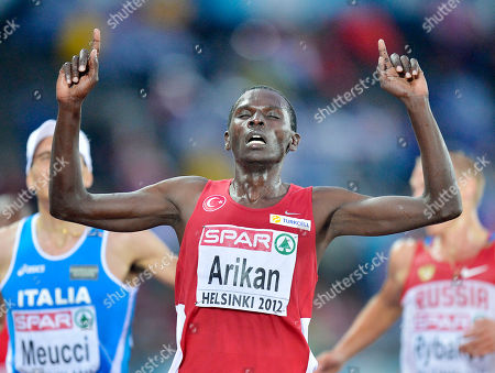 Turkey's Polat Kemboi Arikan crosses the finish lin to win the Men's 10000 meter final at the European Athletics Championships in Helsinki, Finland