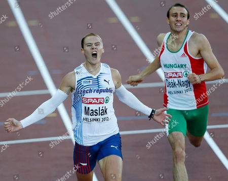 Stock Photo of Czech Republic's Pavel Maslak, left, crosses the finish line ahead of Hungary's Marcell Deak-Nagy to win the 400 meter final at the European Athletics Championships in Helsinki, Finland