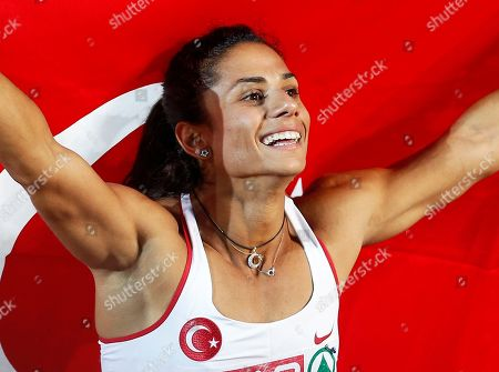 Turkey's Nevin Yanit poses with the national flag after winning the Women's 100 meter Hurdles final at the European Athletics Championships in Helsinki, Finland, .AP Photo/Petr David Josek