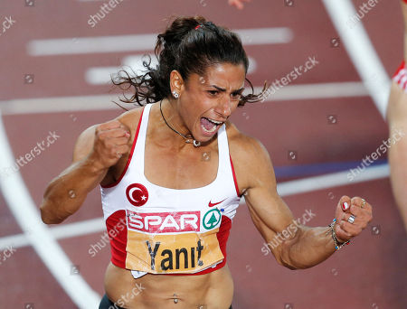 Turkey's Nevin Yanit crosses the finish line to win the Women's 100 meter Hurdles final at the European Athletics Championships in Helsinki, Finland